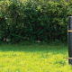 Image of a litter and dog waste disposal bin in a park setting